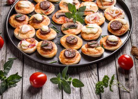 mini pizza: Homemade mini pizza on kitchen pan Stock Photo