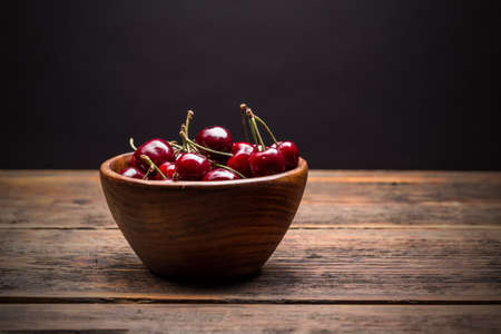 sour cherry: Sour cherry in wooden bowl