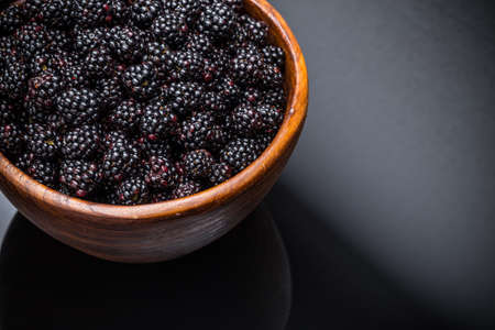brambleberry: Blackberries in a bowl on black background