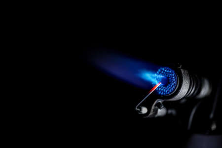 Industrial natural gas burner isolated on black background