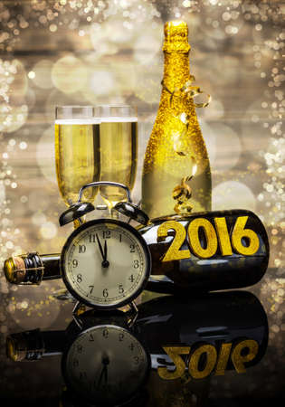 champagne flute: 2016 New Year concept with the date in numbers, clock and bottle of champagne Stock Photo