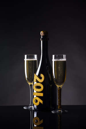 uncork: Glasses with champagne, New Year 2016 concept