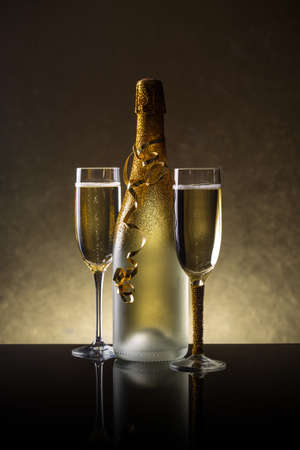 champagne flutes: Champagne bottle and champagne glass in holiday setting