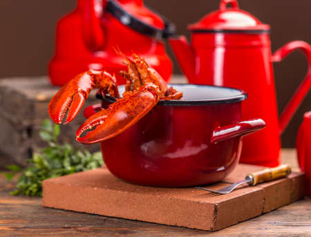 lobster pot: Red lobster on the pots edge