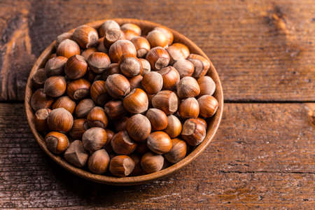 cobnut: Hazelnuts in a wooden bowl on a wooden background Stock Photo