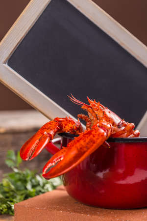 red cooked: Red cooked lobster, chalkboard in background
