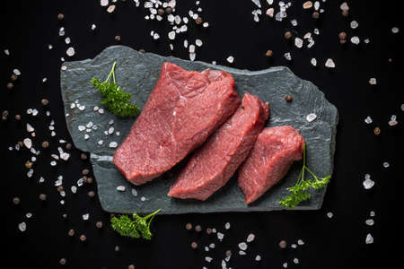 crude: Top view of crude beef meat on stone surface