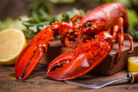 Boiled lobster on old wooden background