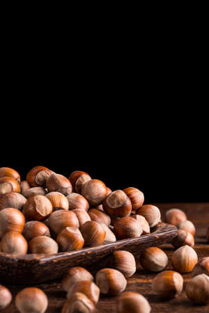 hazelnuts: Hazelnuts in bamboo plate with space for your text Stock Photo