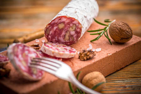 air dried: French salami with walnuts, air dried Stock Photo