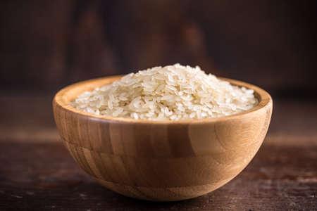 basmati rice: Basmati rice in wooden bowl