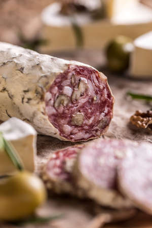 air dried salami: French salami with walnuts, air dried Stock Photo
