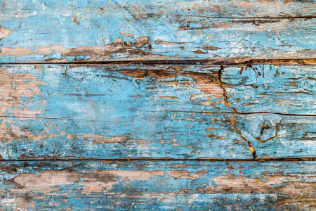 Decrépito azul velho fundo de madeira