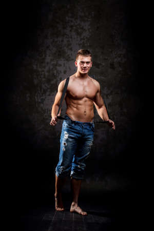 Man showing his muscular body photo