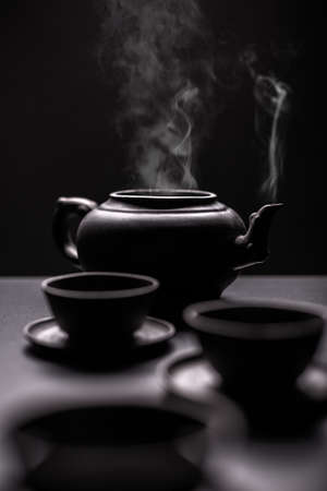 steamy: Tea pot and cups with steamy tea