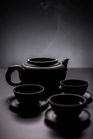 green and black: Three cups of green tea in chinese tea service