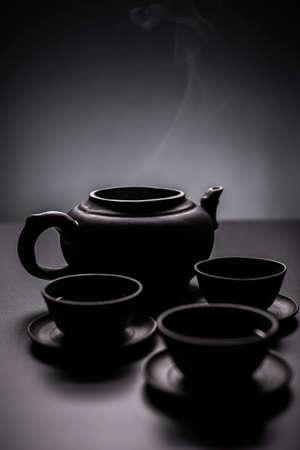 tea service: Three cups of green tea in chinese tea service