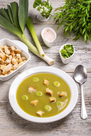 crouton: Leek soup with crouton on wooden background