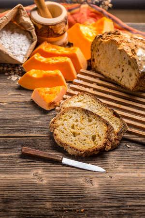 life loaf: Rustic pumpkin bread slice on an old vintage wooden table