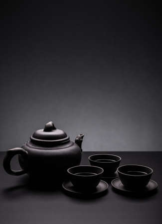 antique dishes: Tea set on black background