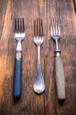 silverware: Vintage silverware on rustic wooden background Stock Photo