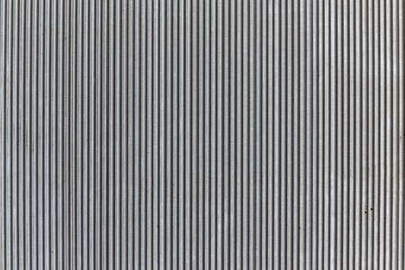 Wavy pattern, corrugated chrome metal sheet background.