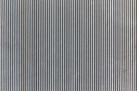 Wavy pattern, corrugated chrome metal sheet background.