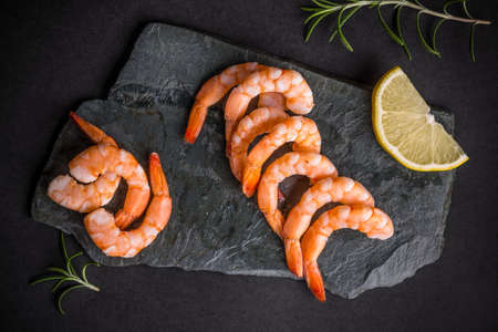shrimp: Top view of shrimps on black slate Stock Photo