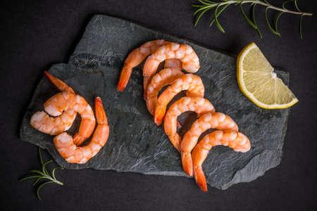 tiger shrimp: Top view of shrimps on black slate Stock Photo