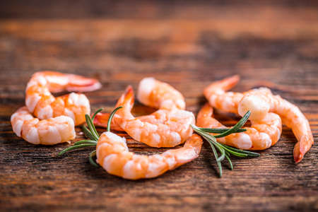 tiger shrimp: Shrimps or prawns on wooden background