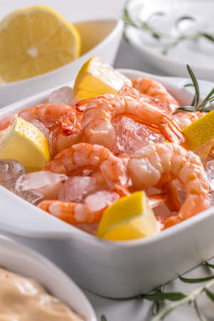 tiger shrimp: Tasty prawns with lemon and ice Stock Photo