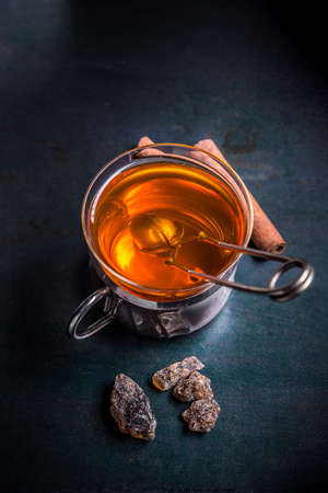 infuser: Glass cup of tea with tea ball infuser