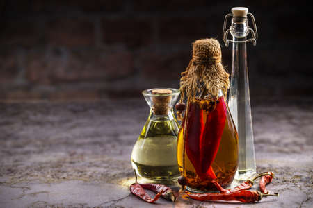 cooking oil: Different sorts of cooking oil on vintage background