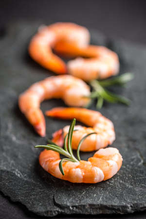 tiger shrimp: Shrimps, prawns on black slate surface