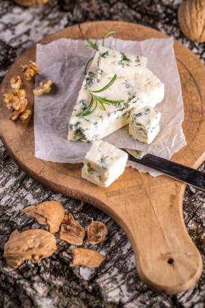 gorgonzola: Gorgonzola cheese with rosemary and walnuts Stock Photo