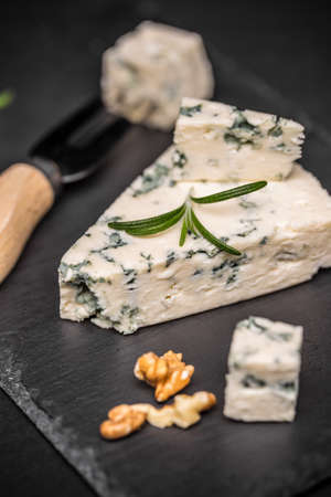 stilton: Blue cheese with nuts on black slate