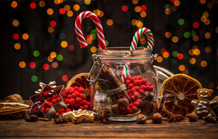 red berries: Christmas decoration with candy canes, orange and red berries Stock Photo