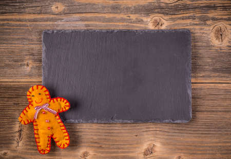 man made: Gingerbread man made of felt with space for your text Stock Photo