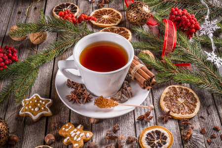 Christmas cup of tea and spices on wooden table Stock Photo