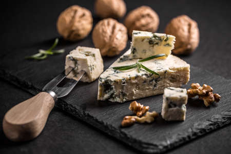 stilton: Blue cheese with nut on black slate