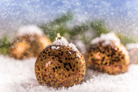 gilded: Gilded Christmas ball in the snow Stock Photo