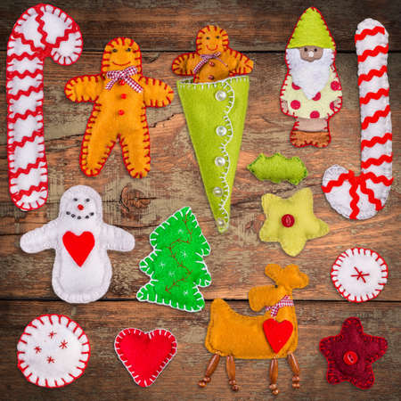 decoration: Felt Christmas decoration on wooden background Stock Photo