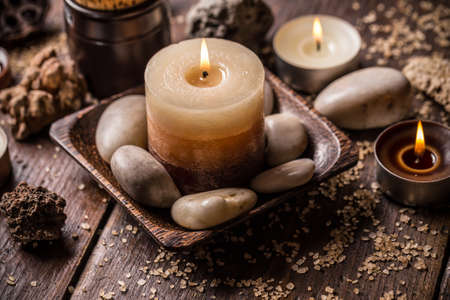 Tranquil spa relaxation setting with candles