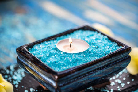aroma bowl: Aromatic sea salt and aroma candle in bowl Stock Photo