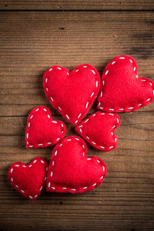 romance: Red felt hearts, symbol of love, romance and friendship for Valentines Day.