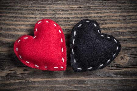 felt: Red and black felt hearts on vintage wooden background
