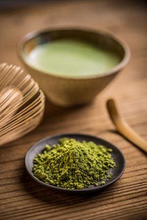 maccha: Matcha, powder green tea in black plate Stock Photo