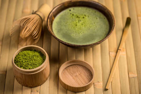 maccha: Still life with Japanese matcha accessories and green tea in bowl