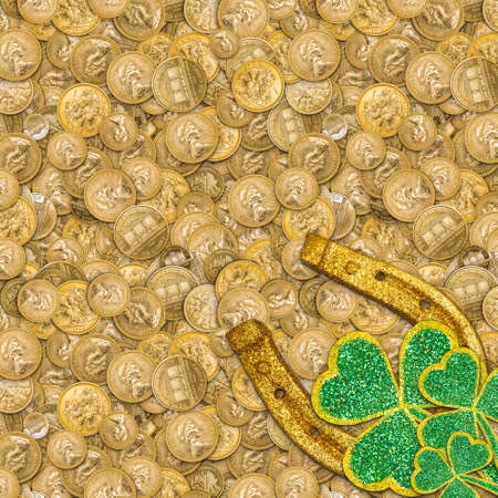 Lucky golden horseshoe background with shamrock on gold coins