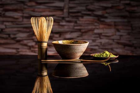 drink tea: Organic green matcha tea in a bowl and matcha utelsils